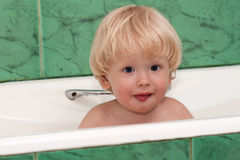 Cute, young boy take a bath Stock Images