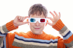 Cute young boy wearing 3D glasses. Isolated over white Royalty Free Stock Images