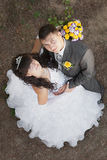 Cute young bride and groom looking up Stock Photos