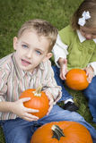 Cute Young Brother and Sister At the Pumpkin Patch Royalty Free Stock Images