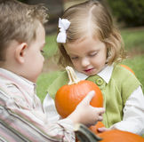 Cute Young Brother and Sister At the Pumpkin Patch Royalty Free Stock Photography