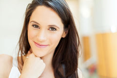 Cute young brunette. Face closeup portrait Stock Image
