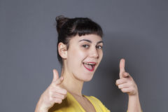Cute young brunette approving with a smile and fingers pointed Royalty Free Stock Images