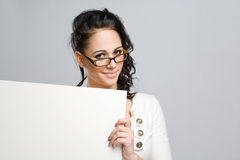 Cute young brunette with blank sign. Stock Photos