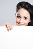 Cute young brunette with blank sign. Stock Photo
