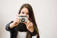 Brunette girl with retro film camera. Royalty Free Stock Images