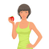 Cute young brunette holding an apple Royalty Free Stock Images