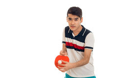 Cute young brunette man in uniform practicing table tennis isolated on white background Stock Photo