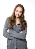 Cute young brunette model. Cute young brunette model, wrapping herself in large warm gray sweater Royalty Free Stock Photos