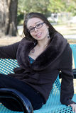 Cute Young Brunette on a Park Bench (1) Royalty Free Stock Photography
