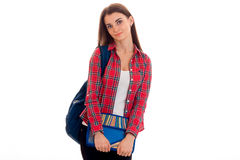 Cute young brunette students teenager in stylish clothes and backpack on her shoulders posing isolated on white.  Stock Images