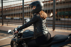 Cute young brunette woman and motorcycle Royalty Free Stock Photography