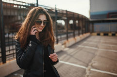 Cute young brunette woman walk and using smartphone Royalty Free Stock Photo
