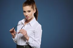 Cute young business woman with glasses.  stock photos