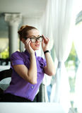Cute young business woman sitting at the table in the restaurant Royalty Free Stock Images