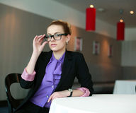 Cute young business woman sitting at the table Stock Photography