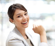 Cute young business woman smiling Stock Photos