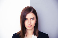 Cute young businesswoman looking at camera Royalty Free Stock Photos