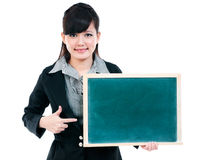 Cute Young Businesswoman Pointing At Blackboard Stock Photos