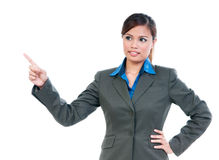 Cute Young Businesswoman Pointing Upward Royalty Free Stock Photos