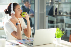 Cute young businesswoman is resting in office Stock Photo