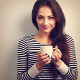 Cute young casual woman holding in hand cup of tea. Vintage tone. D portrait. Closeup Royalty Free Stock Photography