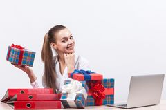 Picture of pretty business lady holding the present boxes royalty free stock image
