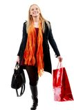 Cute Young caucasian Woman with Shopping Bags in isolated white Royalty Free Stock Image