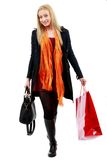 Cute Young caucasian Woman with Shopping Bags in isolated white Royalty Free Stock Photography