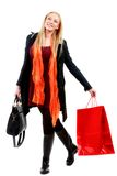 Cute Young caucasian Woman with Shopping Bags in isolated white Royalty Free Stock Photos
