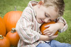 Cute Young Child Boy Enjoying the Pumpkin Patch. Stock Photo