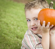 Cute Young Child Boy Enjoying the Pumpkin Patch. Royalty Free Stock Photo