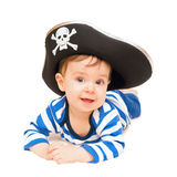 Cute young child dressed as pirate over white Stock Photo