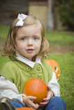 Cute Young Child Girl Enjoying the Pumpkin Patch. Royalty Free Stock Photo