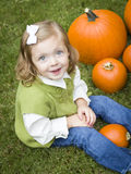 Cute Young Child Girl Enjoying the Pumpkin Patch. Stock Image