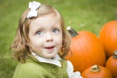 Cute Young Child Girl Enjoying the Pumpkin Patch. Stock Photos