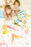 Cute young child girls painting over white Royalty Free Stock Photos