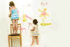 Cute young child girls painting over white Royalty Free Stock Photo