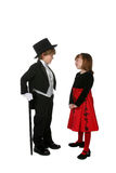 Cute young children in formal dressy clothing. Cute young boy in black tuxedo and girl in red holiday dress Stock Photography