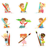 Cute young children holding big pencils, pens and paintbrushes, set for label design. Education and child development. Cartoon detailed colorful Illustrations Royalty Free Stock Photography
