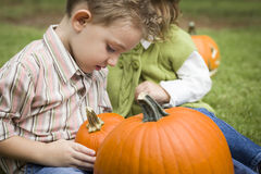 Cute Young Children Playing At the Pumpkin Patch Stock Images