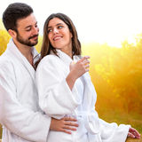 Cute young Couple in bathrobe. Royalty Free Stock Images
