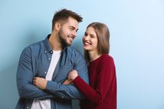 Cute young couple. On color background stock images