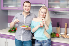 Cute young couple eating healthy breakfast together Royalty Free Stock Photo