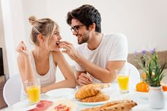 Cute young couple enjoying their breakfast together royalty free stock images