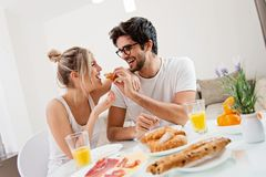 Cute young couple enjoying their breakfast together stock image