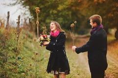Cute young couple having fun. Cute  young couple having fun, sunny autumn day Royalty Free Stock Photos