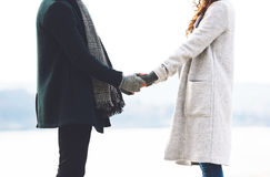 Cute young couple holding hands, close up, outdoors. Cute young couple holding hands, close up Royalty Free Stock Photos
