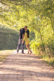 Cute young couple kissing back rear road Stock Photo