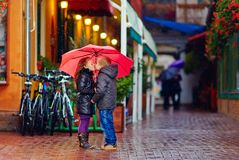 Cute young couple kissing under the rain Royalty Free Stock Images